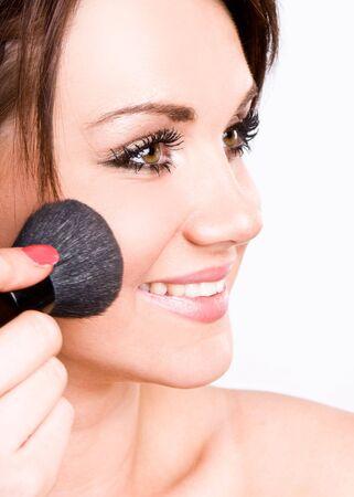 Happy Teenage Girl Applying Make Up photo