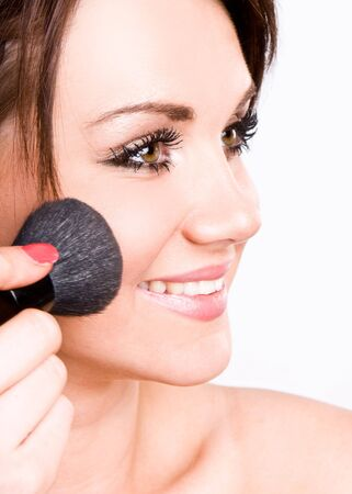 putting up: Happy Teenage Girl Applying Make Up Stock Photo