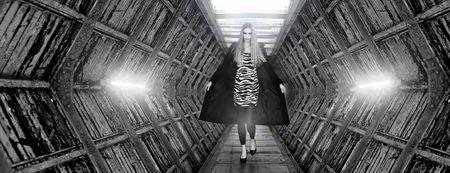 Fashion model doing the catwalk in futuristic place  photo