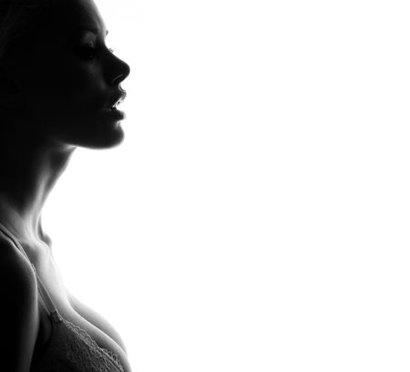 donna completamente nuda: Silhouette di una ragazza di bellezza che indossa il reggiseno. Archivio Fotografico
