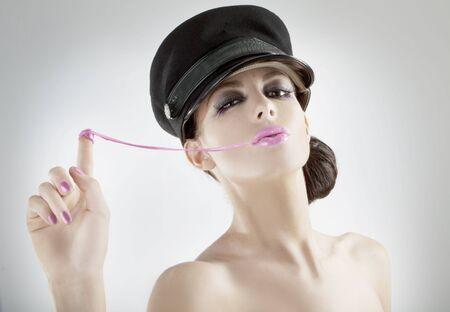 beautiful young girl pulling bubblegum wearing a nice hat Stock Photo - 5888059