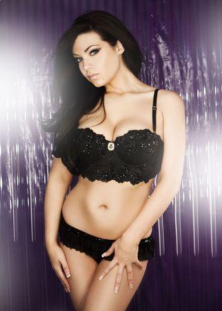 ligueros: Seductor modelo sexy en lencer�a negra  Foto de archivo
