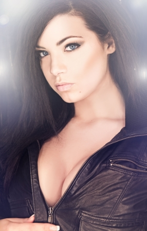 beautiful and sexy brunette girl on dark background - portrait photo
