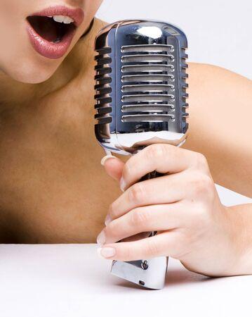 Music star.Sexy woman singing in retro mic Stock Photo - 6182137