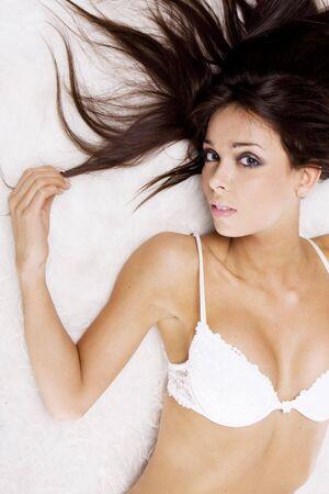 sexy brunette girl on the floor wearing white bra photo