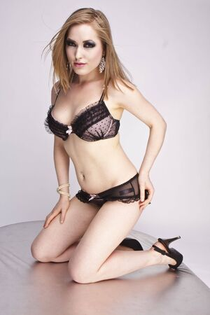 Young sexy woman in black lingerie. Stock Photo - 6184947
