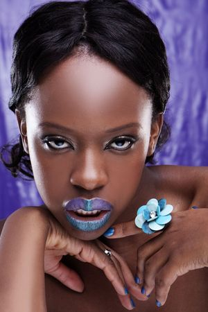 glans: beautiful African woman with beauty violet and blue lips