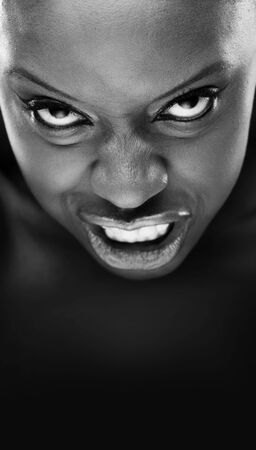 black and white portrait of beautiful African woman screaming  photo