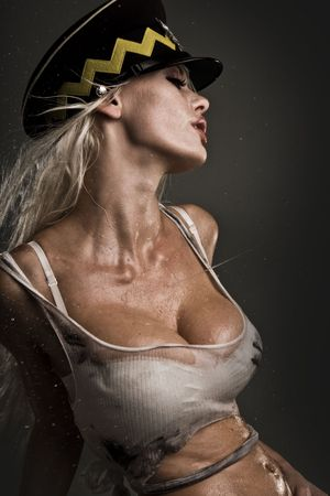 sexy model with wet and dirty skin and hair smoking cigarette photo