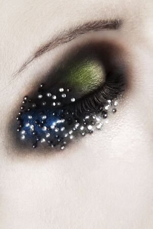 human closed eye with green and blue eyeshadow - macro shoot Stock Photo - 6184982