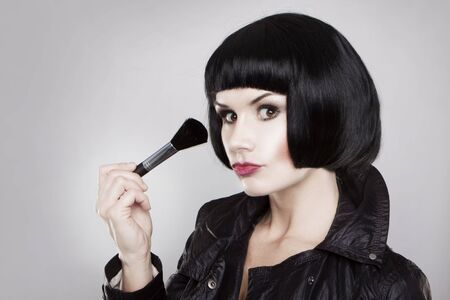 Beautiful portrait of brunette woman makeup with brush Stock Photo - 6255668