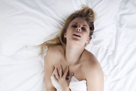 Picture of passionate naked woman on her bed Stock Photo