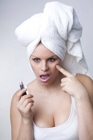 Pimple , spot on beauty woman face with a white towel photo