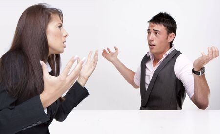 business disagreement: Work Colleagues arguing on white background Stock Photo
