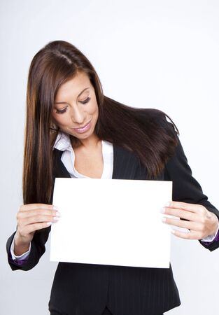 Businesswoman with white copy space in her hands photo