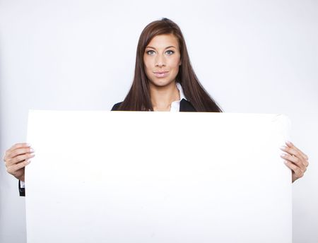 Beautiful business woman holding empty white board Stock Photo - 6384285