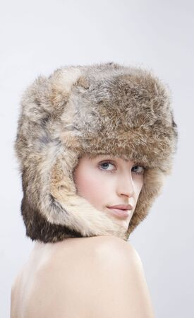 portrait of a beautiful girl in a fur russian hat photo