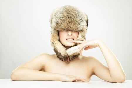 portrait of a beautiful girl in a fur russian hat