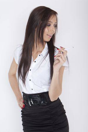 Smiling business woman holding a ciggarette. Isolated over white background Stock Photo - 6678999