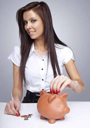 Young Lady brunette Saving Her Pennies Stock Photo - 6678998