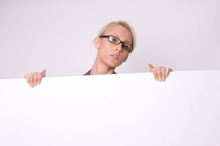 Businesswoman holding blank sign isolated on white Stock Photo - 7015570