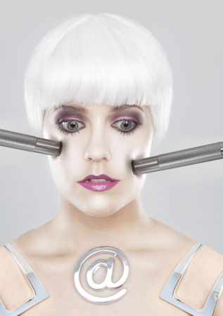 Portrait of a pale, modernistic woman with white hair and metallic probes pressing her face. photo