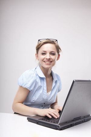 Young business woman on a laptop wearing casual  photo