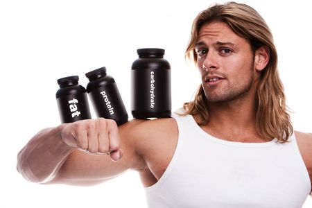 Athletic male body builder holding a boxes with supplements on his biceps