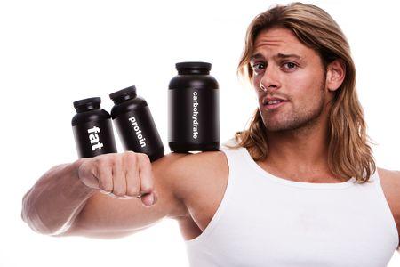 vitamina a: Generador de atl�tica cuerpo masculino sexy sosteniendo una cajas con suplementos sobre su b�ceps  Foto de archivo