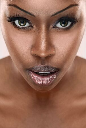beautiful African woman with long false eyelashes and natural make-up photo