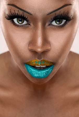 colorfull: beautiful African woman with long false eyelashes and  colorfull lips