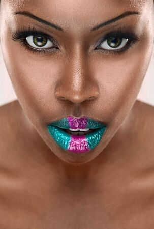 beautiful African woman with long false eyelashes and  colorfull lips photo