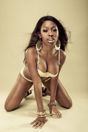 Sexy African American young woman wearing erotic yellow lingerie Stock Photo - 7543630
