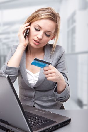 Woman Using Credit Card to Buy Online