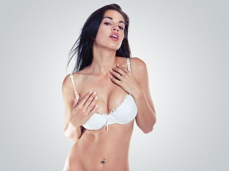 Beautiful and sexy girl wearing white lingerie photo