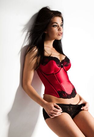 Perfect girls body wearing red corset