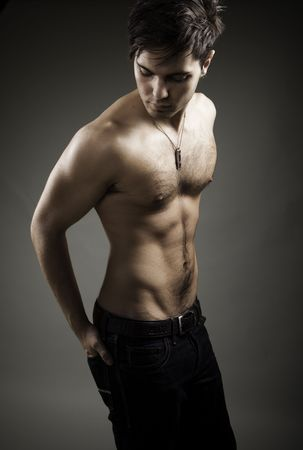 Image of shirtless man in jeans