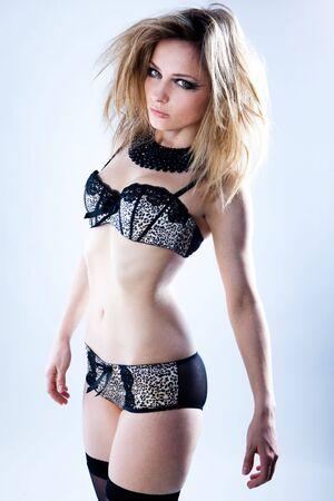Fashion model posing in black lingerie on white Stock Photo - 7682581