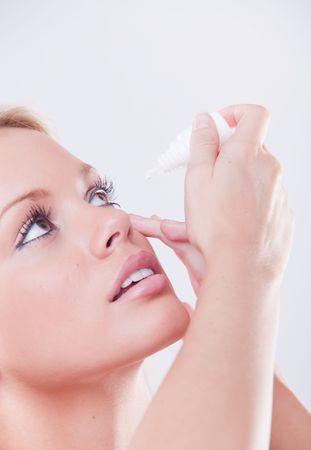 antihistamine: woman`s eye and eyedropper with waterdrop on tip