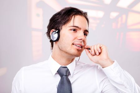 A friendly telephone operator in an office environment. Stock Photo - 7692091