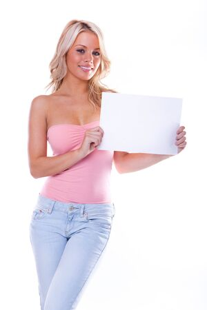 sexy girl holding a blank page isolated over a white background