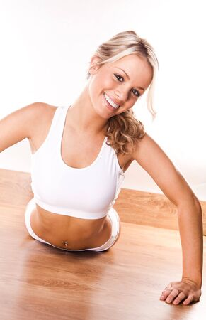 Smiling fitness beauty sexy woman exercising photo