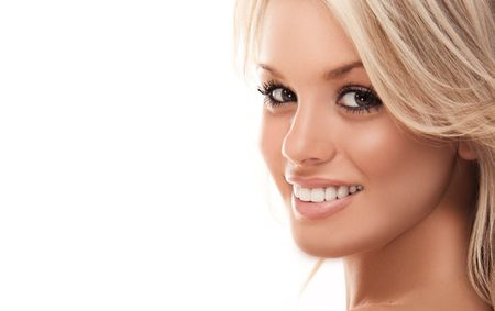 Image with beautiful smiling blonde girl on white background closeup