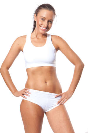 sports bra: Smiling young athletic fitness woman
