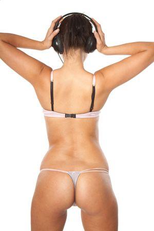 asno: Parte posterior de la mujer feliz disfrutando de m�sica vistiendo lencer�a sexy