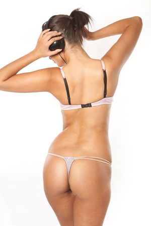 Back of Happy woman enjoying music wearing sexy lingerie