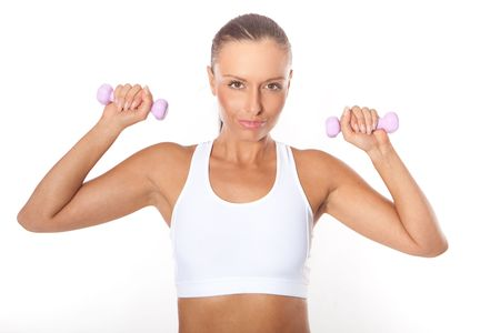 Fitness sexy woman working out with free weights isolated on white  photo