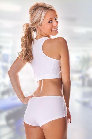 buena postura: Mujer agraciada vistiendo ropa interior, vista trasera, aislado en fondo blanco  Foto de archivo