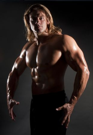 male model torso: Athletic sexy male body builder with the blonde long hair. gladiator
