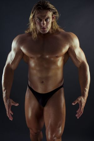 muscular anatomy: Athletic sexy male body builder with the blonde long hair. gladiator